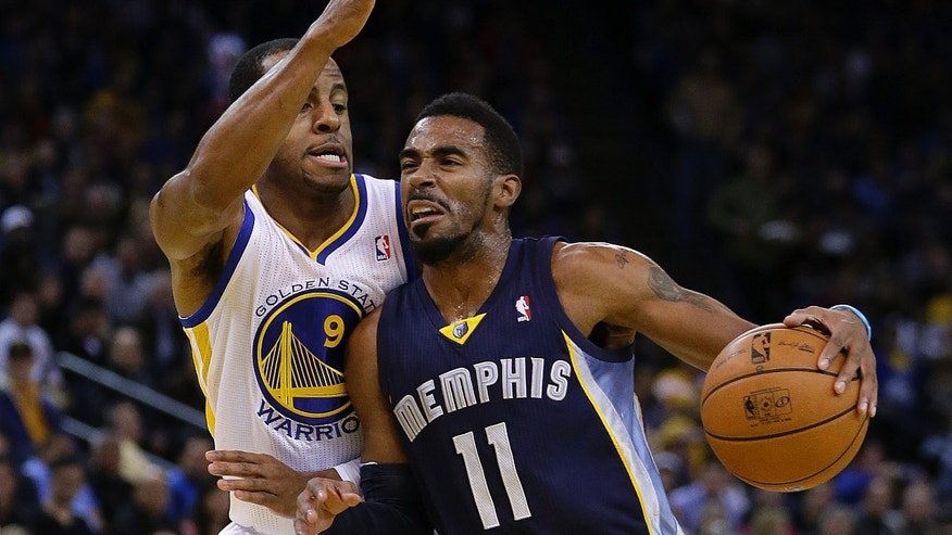 Memphis Grizzlies' Mike Conley (11) drives the ball against Golden State Warriors' Andre Iguodala (9) during the first half of an NBA basketball game on Wednesday, Nov. 20, 2013, in Oakland, Calif. (AP Photo/Ben Margot)