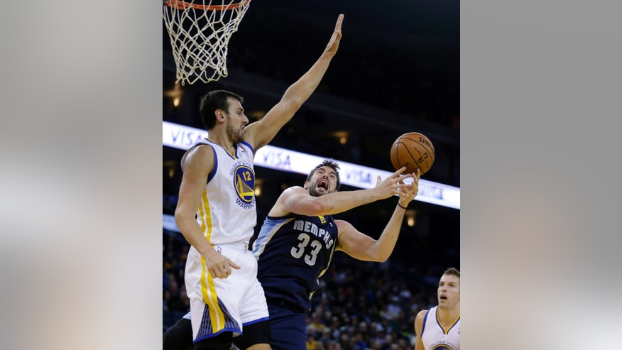 Memphis Grizzlies' Marc Gasol (33) goes up for a shot against Golden State Warriors' Andrew Bogut (12) during the first half of an NBA basketball game on Wednesday, Nov. 20, 2013, in Oakland, Calif. (AP Photo/Ben Margot)