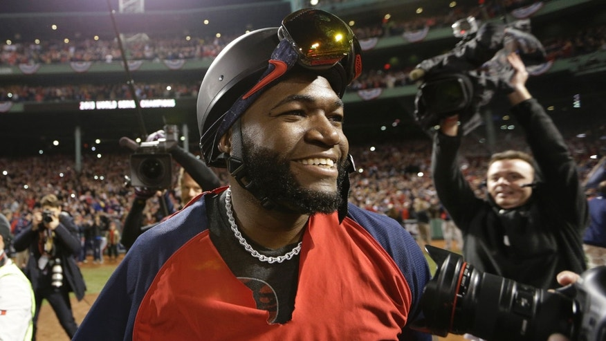 Boston Red Sox designated hitter, David Ortiz, celebrates the team's World Series victory, Oct. 30, 2013.