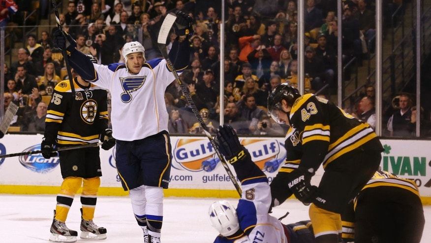 St. Louis Blues right wing Chris Stewart raises his arms as he celebrates with teammate Jaden Schwartz (9) after scoring against Boston Bruins   during the first period of an NHL hockey game, Thursday, Nov. 21, 2013, in Boston.  Bruins Matt Bartkowski stands at right.(AP Photo/Charles Krupa)