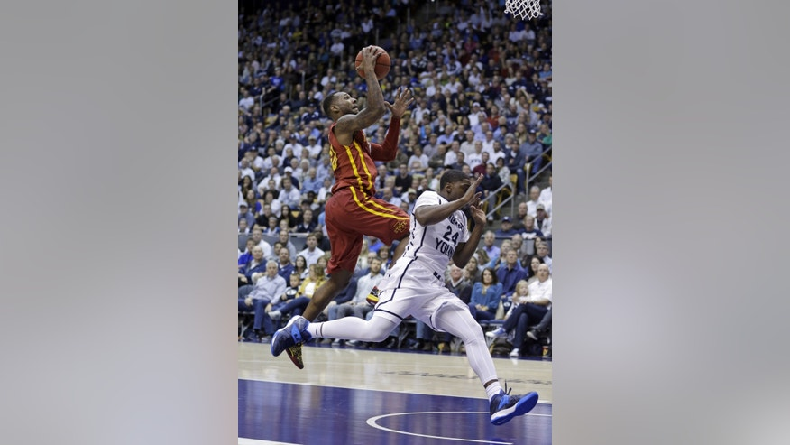 Iowa State's DeAndre Kane, left, goes to the basket as Brigham Young's Frank Bartley IV (24) attempts to defend in the second half during an NCAA college basketball game Wednesday, Nov. 20, 2013, in Provo, Utah. Iowa State won 90-88. (AP Photo/Rick Bowmer)