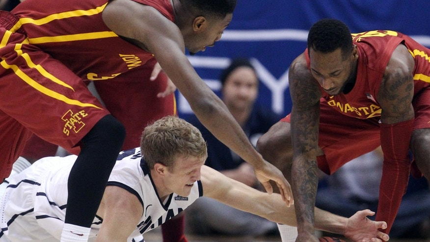 Iowa State's DeAndre Kane, right, and Brigham Young's Tyler Haws, bottom, fight for a loose ball in the second half during an NCAA college basketball game Wednesday, Nov. 20, 2013, in Provo. Iowa State won 90-88. (AP Photo/Rick Bowmer)