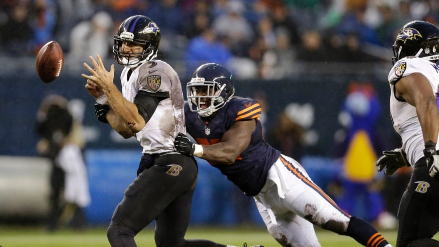 Chicago Bears linebacker Larry Grant, right, sacks Baltimore Ravens quarterback Joe Flacco (5) during the second half of an NFL football game, Sunday, Nov. 17, 2013, in Chicago. (AP Photo/Nam Y. Huh)