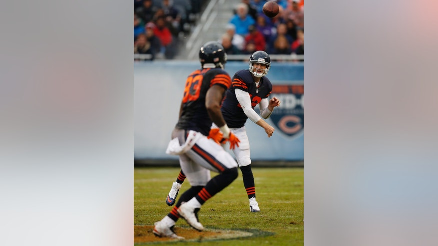 Chicago Bears quarterback Josh McCown (12) passes to tight end Martellus Bennett (83) during the first half of an NFL football game against the Baltimore Ravens, Sunday, Nov. 17, 2013, in Chicago. (AP Photo/Charles Rex Arbogast)