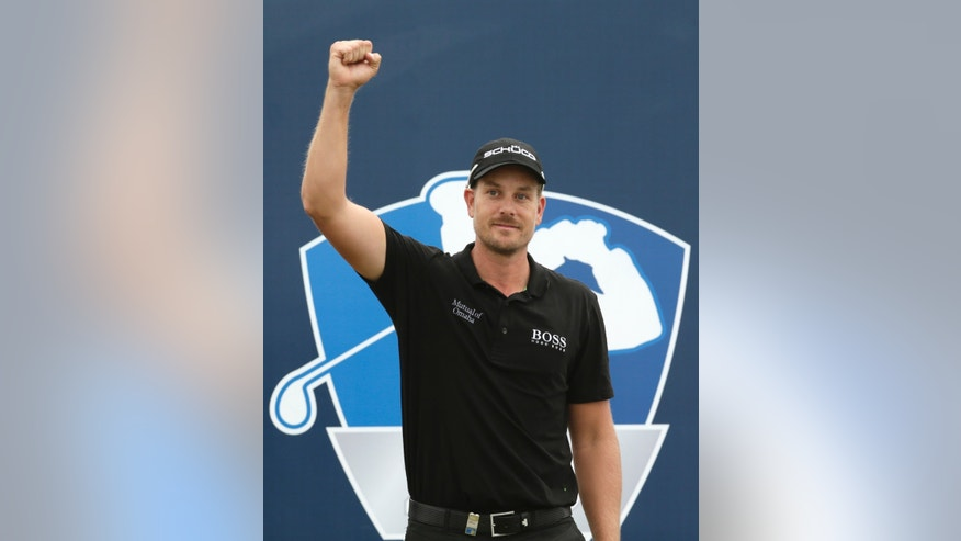 Henrik Stenson from Sweden celebrates after winning the DP World Golf Championship, in Dubai, United Arab Emirates, Sunday, Nov. 17, 2013. (AP Photo/Hassan Ammar)
