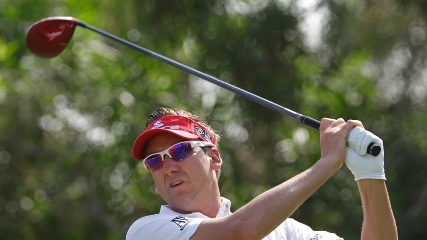 England's Ian Poulter plays a shot on the 3rd hole during the 3rd round of DP World Golf Championship in Dubai, United Arab Emirates, Saturday Nov. 16, 2013. (AP Photo/Kamran Jebreili)