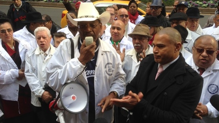 New York State Senator Reverend Ruben Diaz wears a Yankee Jersey and cowboy hat as he leads a prayer session with Fernando Mateo, President of Hispanics Across America, on Thursday for embattled New York Yankees Star Alex Rodriguez.