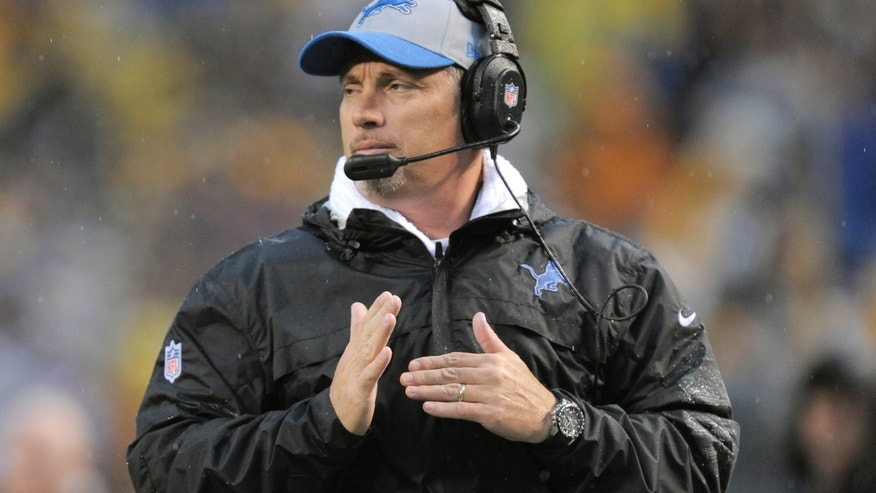 Detroit Lions head coach Jim Schwartz calls a time out in the fourth quarter of an NFL football game against the Pittsburgh Steelers on Sunday, Nov. 17, 2013, in Pittsburgh. (AP Photo/Don Wright)