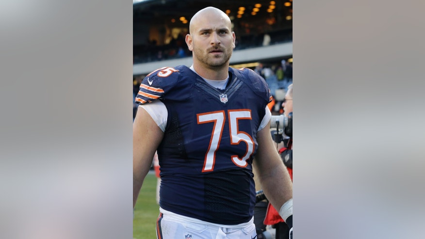 FILE - In this Nov. 10, 2013 file photo, Chicago Bears offensive guard Kyle Long (75) walks off the field after the Bears' 21-19 loss to the Detroit Lions in an NFL football game, in Chicago. Brothers Kyle and Chris Long go head-to head in Sunday's, Nov. 24, 2013, Bears-Rams game while father Howie Long, a Hall of Famer, looks on. (AP Photo/Nam Y. Huh, File)