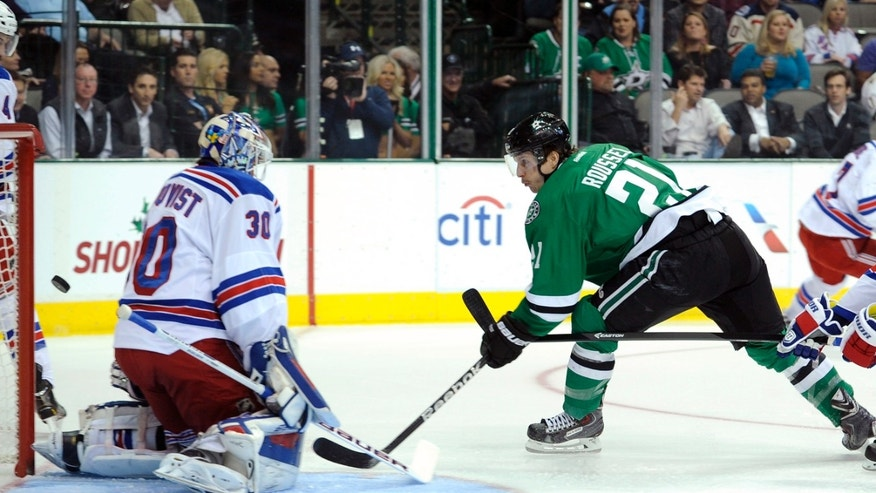 Dallas Stars left wing Antoine Roussel (21) gets a shot off wide of New York Rangers goalie Henrik Lundqvist (30) during the first period of an NHL hockey game, Thursday Nov. 21, 2013 in Dallas. (AP Photo/Matt Strasen)