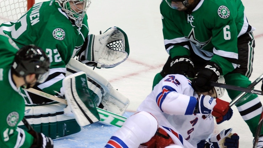 From left, Dallas Stars center Tyler Seguin, goalie Kari Lehtonen (32), defenseman Trevor Daley (6) and New York Rangers center Brian Boyle (22) go after a puck during the second period of an NHL hockey game, Thursday Nov. 21, 2013 in Dallas. (AP Photo/Matt Strasen)