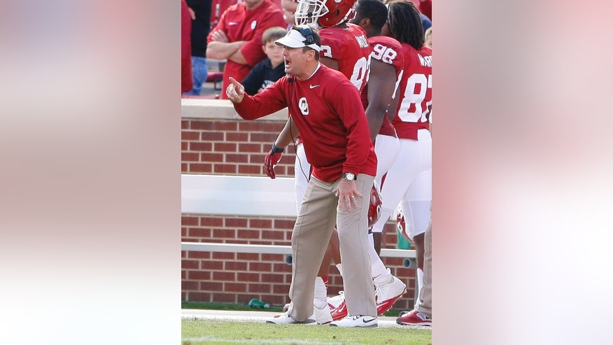 Oklahoma head coach Bob Stoops yells to his team as they play against Iowa State in the fourth quarter of an NCAA college football game in Norman, Okla. on Saturday, Nov. 16, 2013. Oklahoma won 48-10.  (AP Photo/Alonzo Adams)