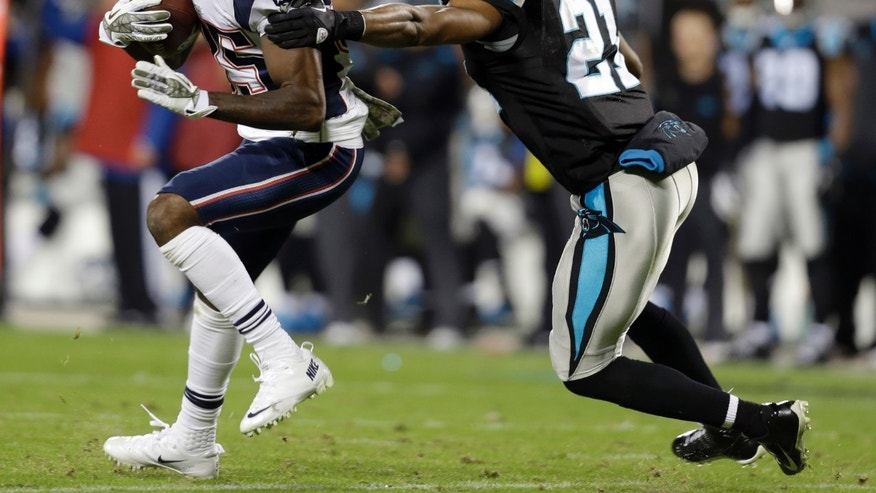 New England Patriots' Kenbrell Thompkins (85) runs after a catch as Carolina Panthers' Mike Mitchell (21) defends during the second half of an NFL football game in Charlotte, N.C., Monday, Nov. 18, 2013. (AP Photo/Gerry Broome)