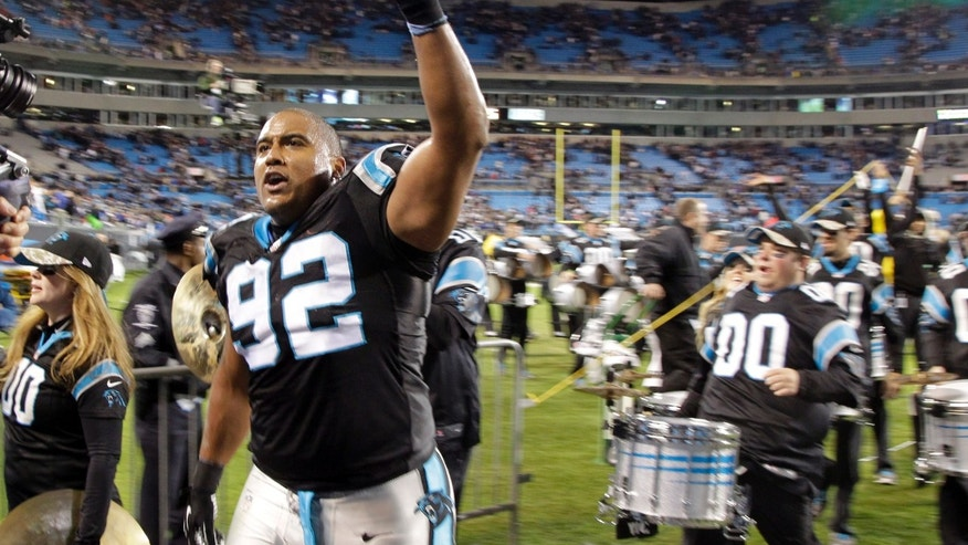 Carolina Panthers' Dwan Edwards (92) react after an NFL football game against the New England Patriots in Charlotte, N.C., Monday, Nov. 18, 2013. The Panthers won 24-20. (AP Photo/Bob Leverone)