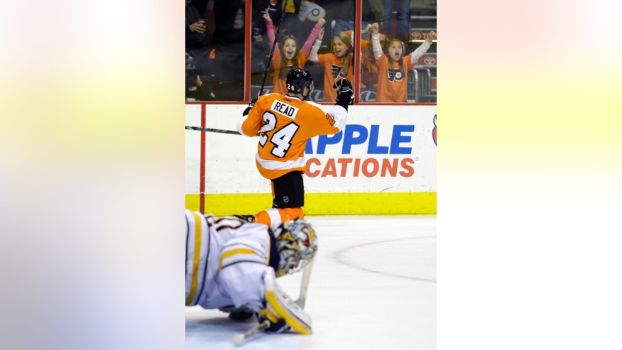 Philadelphia Flyers' Matt Read, top, celebrates after scoring a goal past Buffalo Sabres' Ryan Miller during the second period of an NHL hockey game Thursday, Nov. 21, 2013, in Philadelphia. (AP Photo/Matt Slocum)