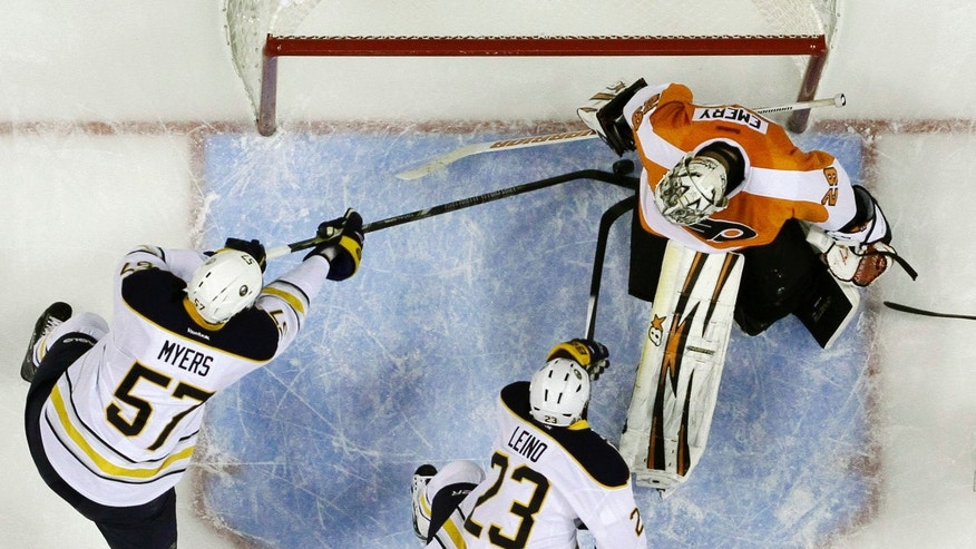 Buffalo Sabres' Tyler Myers (57) scores a goal past Philadelphia Flyers' Ray Emery, top right, as Ville Leino (23), of Finland, assists during the first period of an NHL hockey game Thursday, Nov. 21, 2013, in Philadelphia. (AP Photo/Matt Slocum)