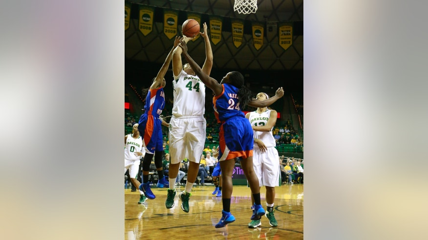 Baylor center Kristina Higgins (44) get foul by Savannah State forward Charmaine Greene (24) and  Bria Dorsey (1) during the first half of an NCAA college basketball game, Thursday, Nov. 21, 2013, in Waco, Texas. Baylor won 69-64. (AP Photo/Jose Yau)