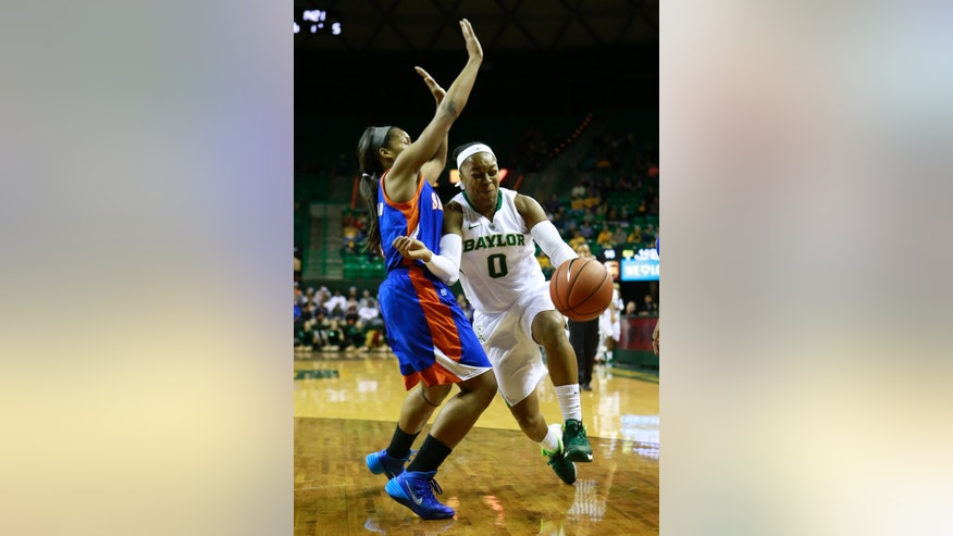 Baylor guard Odyssey Sims (0) tries to pass by Savannah State guard Jasmine Norman (4)  during the first half of an NCAA college basketball game, Thursday, Nov. 21, 2013, in Waco, Texas. Baylor won 69-64. (AP Photo/Jose Yau)
