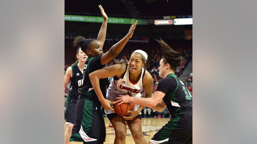 Louisville's Antonita Slaughter, center, battles Ohio's Kiyanna Black, left, and Kat Yelle for the ball during the first half of their NCAA college basketball game on Thursday Nov. 21, 2013, in Louisville, Ky. (AP Photo/Timothy D. Easley)