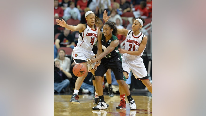 Ohio's Destini Cooper, center, passes the ball away from the defensive pressure of Louisville's Antonita Slaughter, left, and Bria Smith during the first half of their NCAA college basketball game on Thursday Nov. 21, 2013, in Louisville, Ky. (AP Photo/Timothy D. Easley)