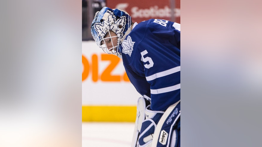 Toronto Maple Leafs goaltender Jonathan Bernier reacts shortly after Nashville Predators score their fourth goal during the third period of an NHL hockey game, Thursday, Nov. 21, 2013 in Toronto. (AP Photo/The Canadian Press, Chris Young)