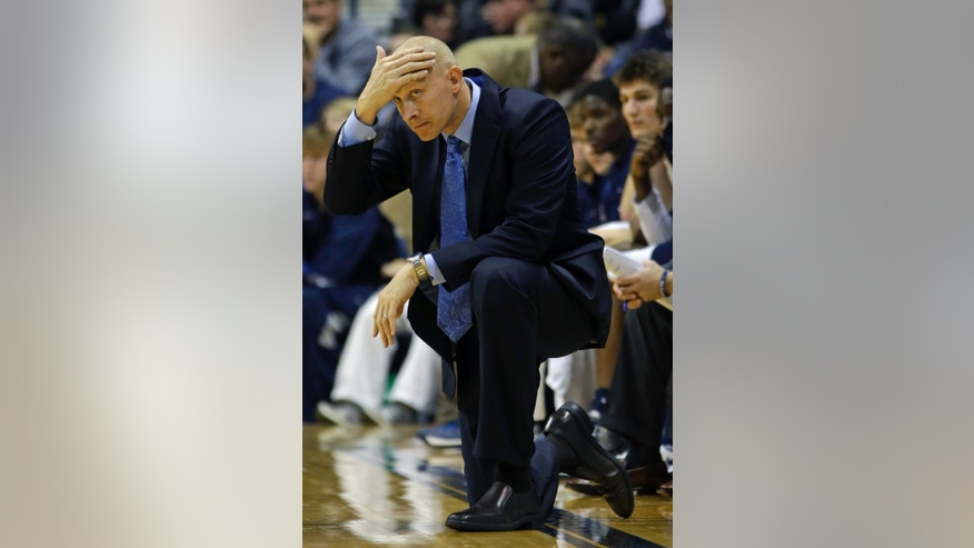 Xavier head coach Chris Mack watches on the sideline in the second half of an NCAA college basketball game against Miami of Ohio, Wednesday, Nov. 20, 2013, in Cincinnati. (AP Photo/Al Behrman)