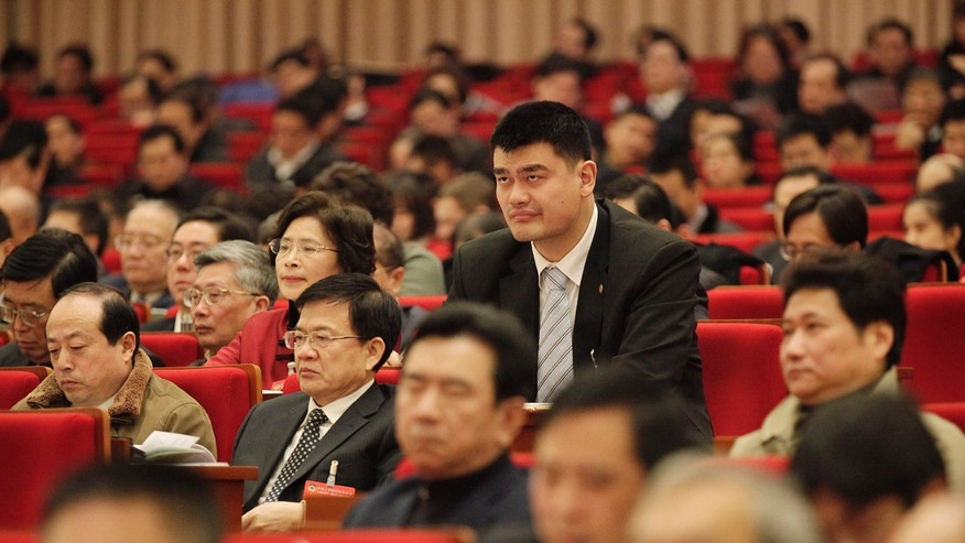 ADVANCE FOR WEEKEND EDITIONS, NOV. 23-24 - FILE - In this Jan. 10, 2012 file photo, delegate Yao Ming, center, a retired NBA basketball star, attends the opening session of the 5th Plenary Session of the 11th Chinese People's Political Consultative Conference (CPPCC) Shanghai Committee, in Shanghai, China. Yao wears a lot of different hats since hanging up his size 18 shoes and retiring in 2011.  ( AP Photo/Eugene Hoshiko, File)