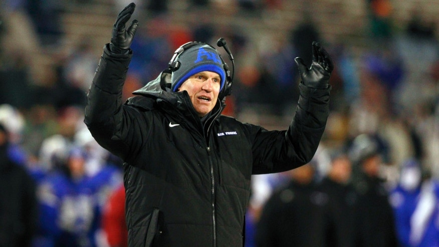 Air Force head coach Troy Calhoun signals for a touchdown for his team against UNLV in the second quarter of an NCAA football game at Air Force Academy, Colo., on Thursday, Nov. 21, 2013. (AP Photo/David Zalubowski)