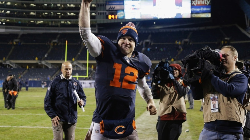 Chicago Bears quarterback Josh McCown (12) celebrates after the Bears' 23-20 win over the Baltimore Ravens in overtime in an NFL football game, Sunday, Nov. 17, 2013, in Chicago. (AP Photo/Nam Y. Huh)