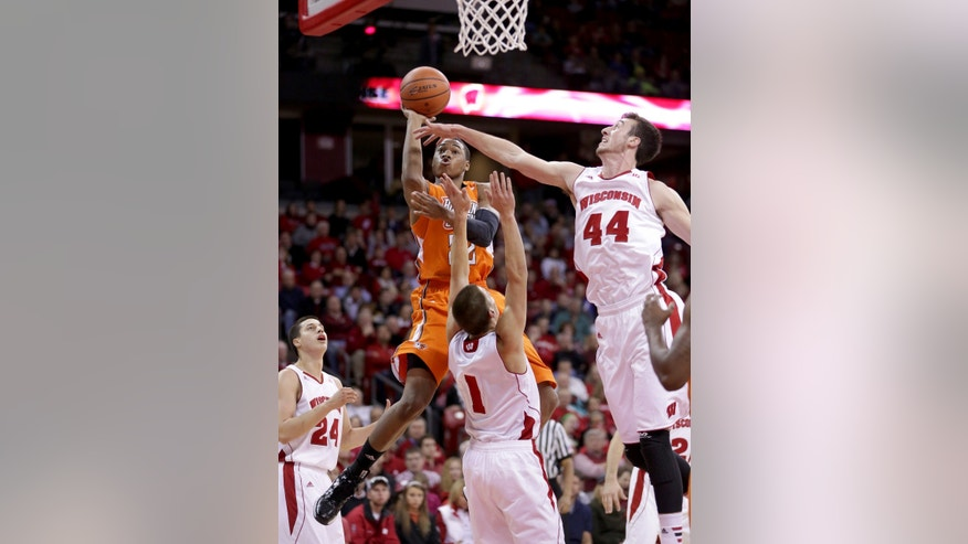 Bowling Green's Richaun Holmes (22), with ball, shoots as Wisconsin's Frank Kaminsky (44) and Ben Brust (1) defend during the first half of an NCAA college basketball game on Thursday, Nov. 21, 2013, in Madison, Wis. (AP Photo/Craig Schreiner)