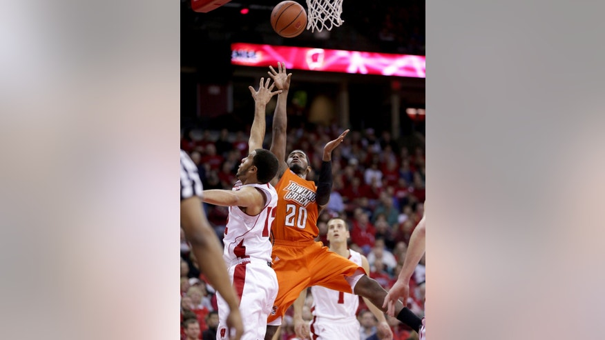 Bowling Green's Jehvon Clarke (20) shoots past Wisconsin's Traevon Jackson (12) during the first half of an NCAA college basketball game on Thursday, Nov. 21, 2013, in Madison, Wis. (AP Photo/Craig Schreiner)