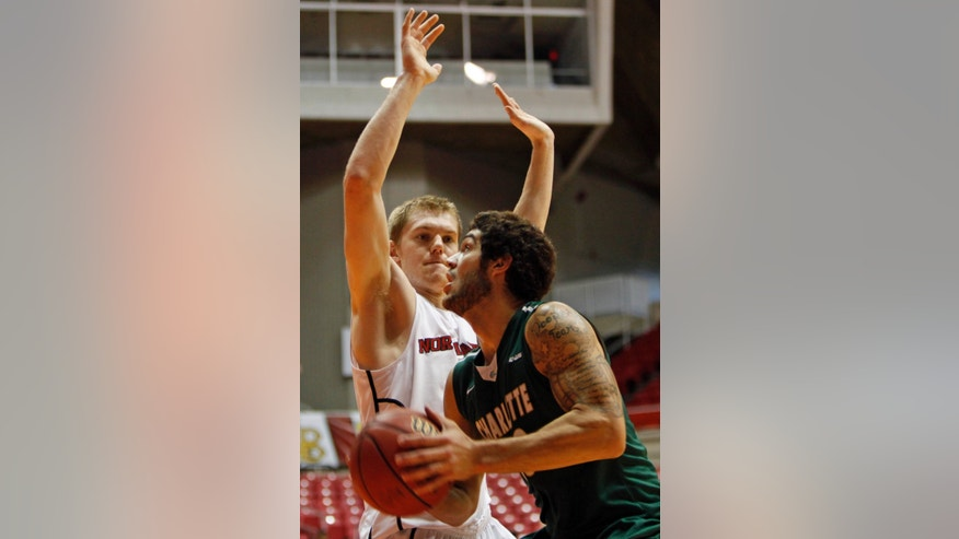 Northeastern forward Scott Eatherton, left, pressures Charlotte forward Marcus Bryan during a NCAA college basketball game in San Juan, Puerto Rico, Friday, Nov. 22, 2013. (AP Photo/Ricardo Arduengo)