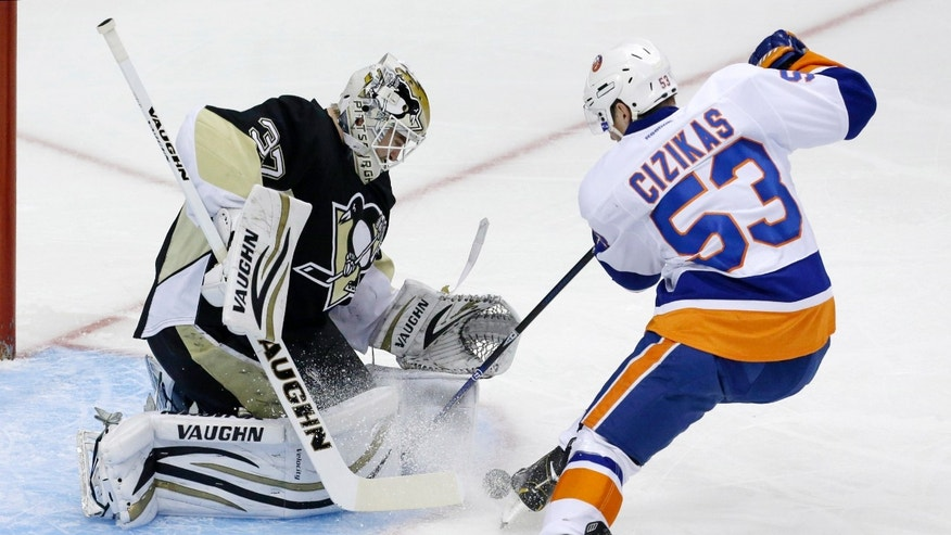 Pittsburgh Penguins goalie Jeff Zatkoff (37) stops a shot by New York Islanders' Casey Cizikas (53) in the first period of an NHL hockey game in Pittsburgh, Friday, Nov. 22, 2013. (AP Photo/Gene J. Puskar)