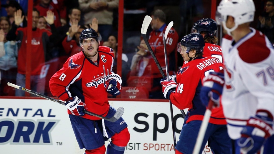 Washington Capitals right wing Alex Ovechkin (8), of Russia, celebrates after his goal in the first period of an NHL hockey game against the Montreal Canadiens, Friday, Nov. 22, 2013, in Washington. (AP Photo/Alex Brandon)