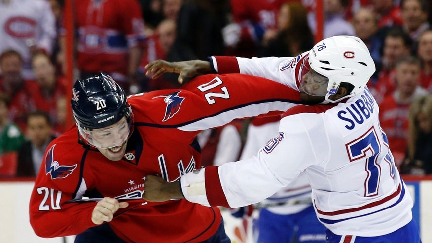 Washington Capitals right wing Troy Brouwer (20) and Montreal Canadiens defenseman P.K. Subban fight in the first period of an NHL hockey game Friday, Nov. 22, 2013, in Washington. (AP Photo/Alex Brandon)