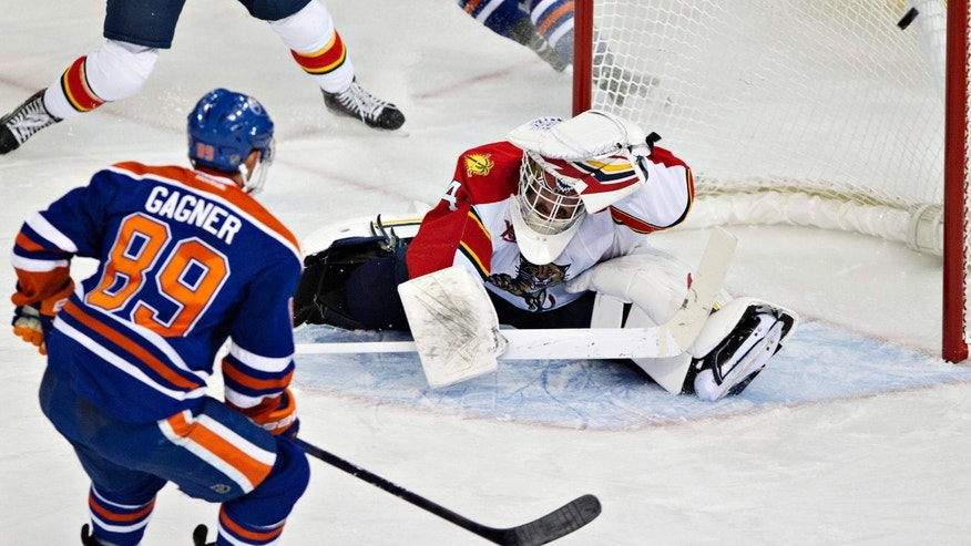 Florida Panthers goalie Tim Thomas (34) is scored on by Edmonton Oilers' Sam Gagner (89) during second period NHL hockey action in Edmonton, Alberta, on Thursday Nov. 21, 2013.(AP Photo/The Canadian Press, Jason Franson)