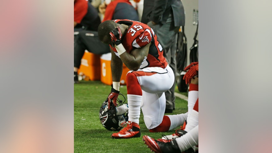 Atlanta Falcons running back Antone Smith (35) sits on the bench during the second half of an NFL football game against the New Orleans Saints, Thursday, Nov. 21, 2013, in Atlanta. The New Orleans Saints won 17-13. (AP Photo/John Bazemore)