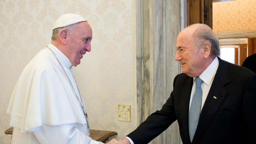 "In this photo provided by the Vatican newspaper L'Osservatore Romano Pope Francis shakes hands  with  FIFA president Joseph Sepp Blatter, left, during their meeting at the Vatican Friday, Nov. 22, 2013. ""We spoke the same language and it was language of football,"" Blatter said during a press conference following the meeting, ' It was really a meeting between two sportsmen and two football fans.""(AP Photo/L' Osservatore Romano, ho)"
