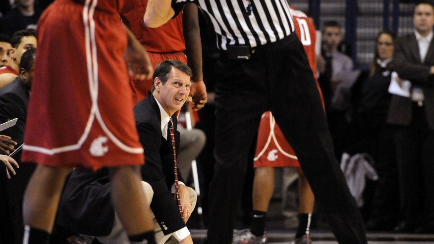 Washington State's head coach, Ken Bone, crouches on the sideline in the second half of an NCAA college basketball game against Gonzaga, Thursday, Nov. 21, 2013, in Spokane, Wash. Gonzaga defeated Washington State 90-74. (AP Photo/Jed Conklin)