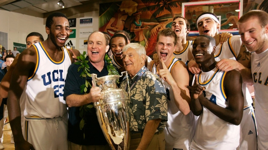 ADVANCE FOR WEEKEND EDITIONS, NOV. 23-24 - FILE - In this Nov. 22, 2006, file photo, UCLA coach Ben Howland, second from left, and his team is presented with the championship trophy by Wayne Duke, tournament chairmen emeritus, after UCLA defeated Georgia Tech 88-73 in the championship game at the Maui Invitational college basketball tournament in Lahaina, Hawaii. The Maui Invitational turns 30 this week. (AP Photo/Michael Conroy, File)