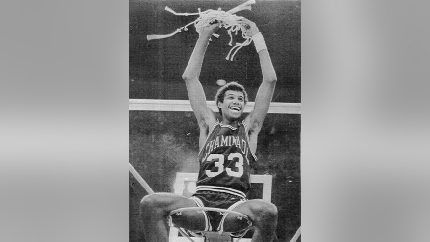 ADVANCE FOR WEEKEND EDITIONS, NOV. 23-24 - FILE - In this Dec. 23, 1982, file photo, Chaminade's Richard Haenisch sits atop the basket celebrating their 77-72 win over No. 1 Virginia in a college basketball game in Honolulu. For the 30th time some of the best teams in college basketball will make the trip halfway across the Pacific Ocean accompanied by fans who will root them on in between scuba lessons, whale watching, golf and parasailing. (AP Photo/The Star-Advertiser, File)