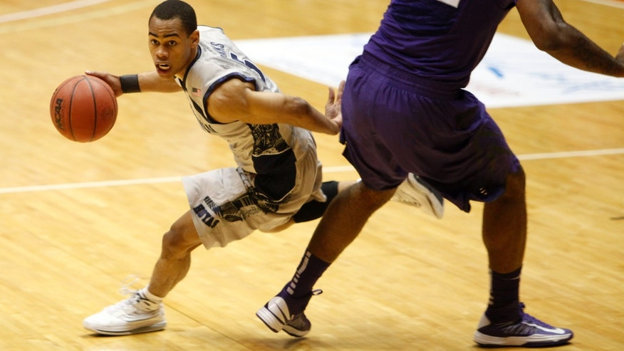 Georgetown guard Markel Starks, left, drives the ball past Kansas State forward Thomas Gibson during an NCAA college basketball game in San Juan, Puerto Rico, Friday, Nov. 22, 2013. (AP Photo/Ricardo Arduengo)