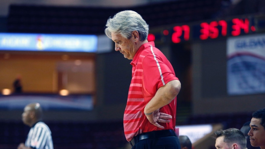 New Mexico's head coach Craig Neal looks dejected during their game against Massachusetts in the first half at the Charleston Classic NCAA college basketball tournament in Charleston, S.C., Friday, Nov. 22, 2013.  Massachusetts defeated New Mexico 81-65. (AP Photo/Mic Smith)