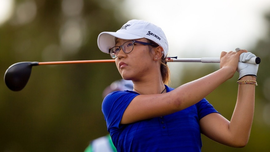 Lydia Ko, from New Zealand,  tees off the second tee in the first round of the LPGA CME Group Titleholders at the Tiburon Golf Club on Thursday, Nov. 21, 2013, in Naples, Fla. The event is Ko's debut as a professional golfer.  (AP Photo/Naples Daily News, David Albers) Fort Myers Out