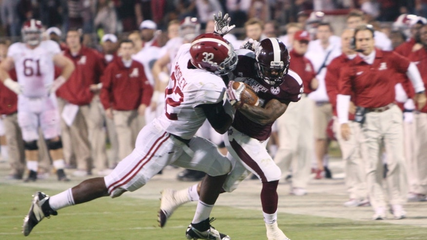 Mississippi State running back LaDarius Perkins (27) is tackled by Alabama linebacker C.J. Mosley (32) during the second half of an NCAA college football game, Saturday, Nov. 16, 2013, in Starkville, Miss. Alabama won 20-7. (AP Photo/Kerry Smith )
