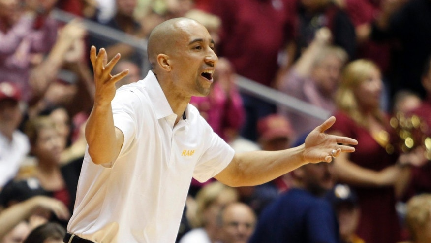 VCU head coach Shaka Smart directs his team during the second half of an NCAA college basketball game against Florida State in San Juan, Puerto Rico, Thursday, Nov. 21, 2013. (AP Photo/Ricardo Arduengo)