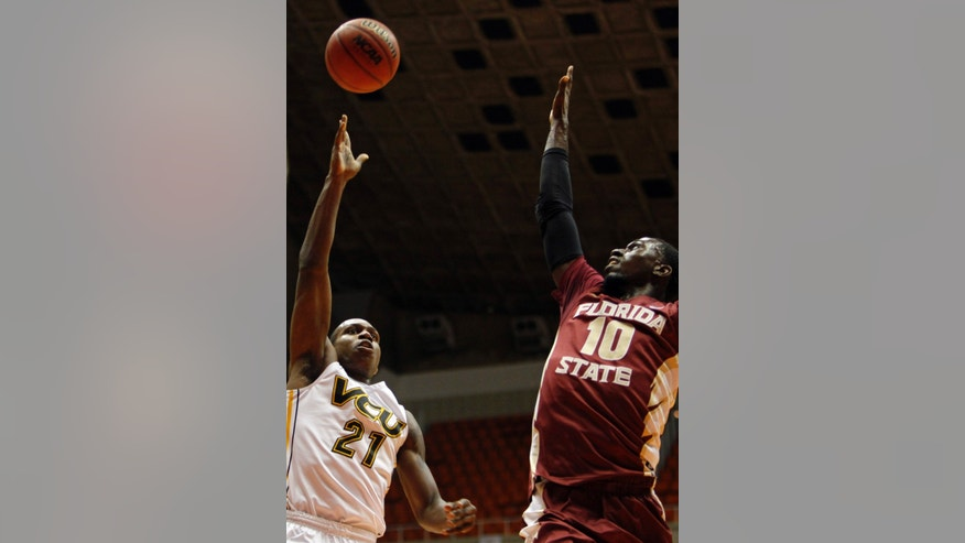 VCU forward Treveon Graham, left, goes up for the basket against Florida State's forward Okaro White during an NCAA college basketball game in San Juan, Puerto Rico, Thursday, Nov. 21, 2013. (AP Photo/Ricardo Arduengo)