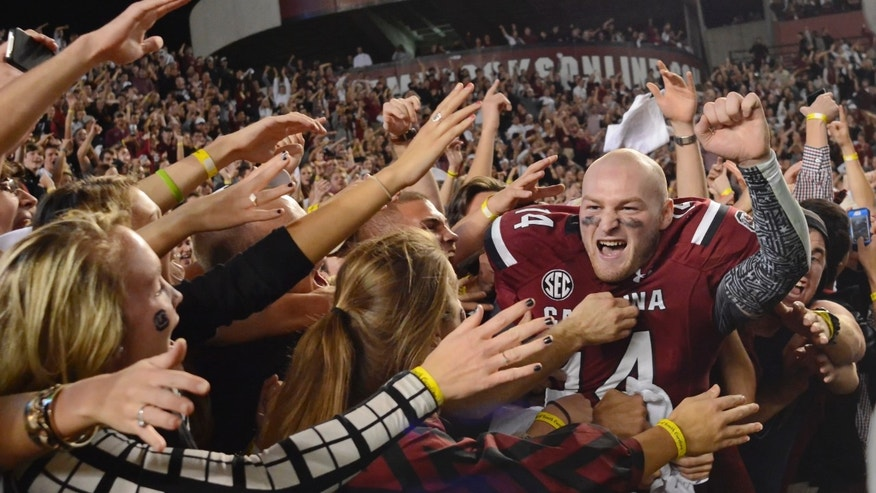 South Carolina quarterback Connor Shaw celebrates the team's 19-14 win over Florida in an NCAA college football game Saturday, Nov. 16, 2013, at Williams-Brice Stadium in Columbia, S.C. (AP Photo/Richard Shiro)
