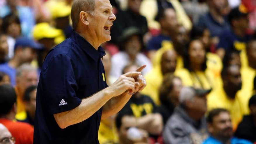 Michigan's head basketball coach John Beilein yells to his players during the first half of an NCAA college basketball game against Long Beach State in San Juan, Puerto Rico, Thursday, Nov. 21, 2013. (AP Photo/Ricardo Arduengo)