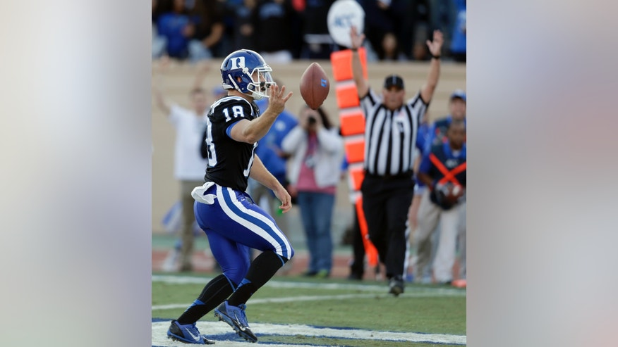 Duke quarterback Brandon Connette runs the ball into the end zone for a touchdown during the first half of an NCAA college football game against Miami in Durham, N.C., Saturday, Nov. 16, 2013. (AP Photo/Gerry Broome)